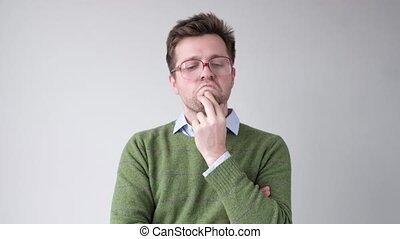 man in big glasses trying to make a decision and solve problem.