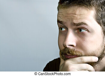 Pensive young man - Portrait of young pensive bearded guy