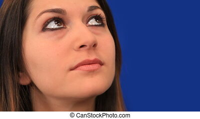 Pensive young woman looking up - Blue Screen Background -...