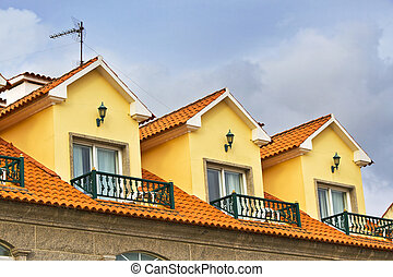 Yellow attic on a building on the roof