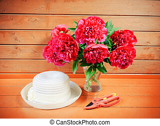 Peonies on wooden background