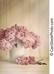 Peony flowers in vase with vintage colors