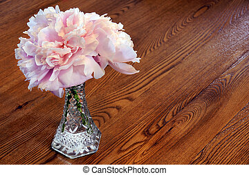 Peony flowers on wooden table