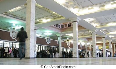 People about ticket offices in station hall, indoor in Moscow.