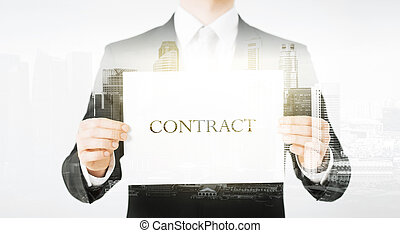 close up of businessman holding contract paper