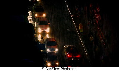 People And Cars In Heavy Rain