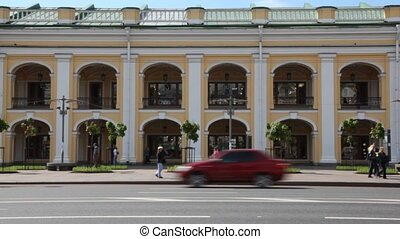 People and cars move near Guest Court (Gostiny Dvor) -...