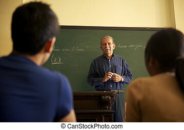 People and education, professor talking to students during lesson in college, Law School, University of Havana, Cuba