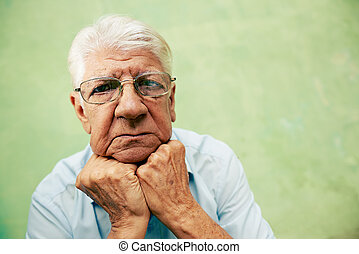 people and emotions, portrait of depressed senior hispanic...