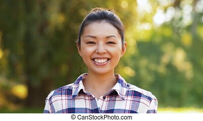 outdoor portrait of smiling asian woman in summer - people...
