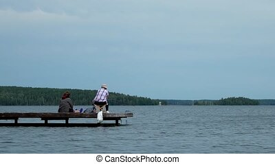 People and family recreation, senior man and women fishing together on lake