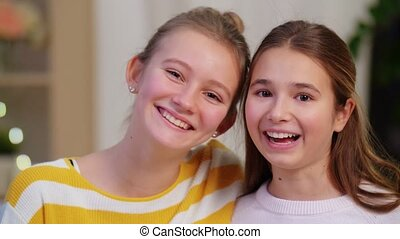 portrait of happy teenage girls at home - people and ...