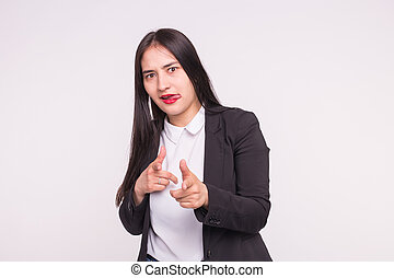 People and gesture concept - asian woman dressed in white shirt and black jacket showing bang-bang gesture over white background
