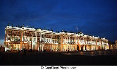 People and horse harnessed to carriage Hermitage on Palace square illuminated