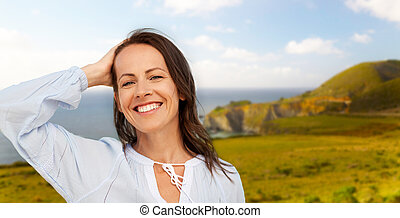 smiling woman over big sur coast of california