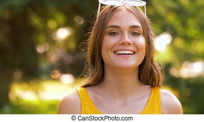 portrait of happy teenage girl in summer park - people and...