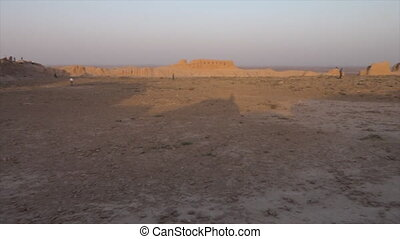 People and panoramic ruins in Uzbekistan - A wide,...