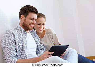 happy couple with tablet pc computer