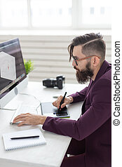 People and technology concept - Low angle view of an artist drawing something on graphic tablet