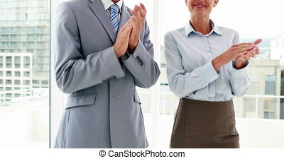 People applauding the camera - Business people shaking hands...