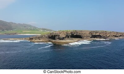 People are climbing on the cliffs at Muckross Head, County Donegal - Ireland.
