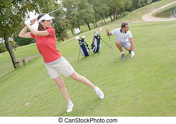 people are doing a backswing