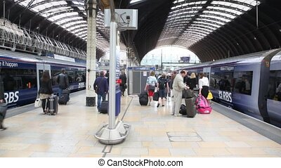 people are going on platform of Charing Cross station in...