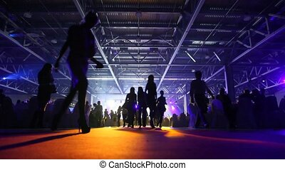 People are in hall which takes place banquet. - People are...