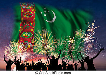 People are looking on fireworks and flag of Turkmenistan
