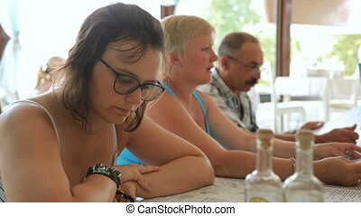 People are looking through menu in cafe