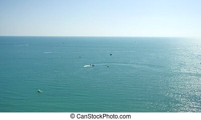 People are playing a jet ski in the sea.Aerial view. Top...