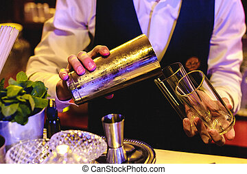 people are resting at a banquet. the barman pours drinks