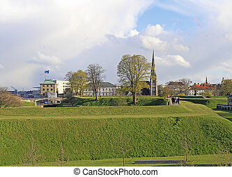 people are running by hills of Kastellet, Copenhagen