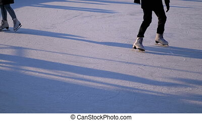 People are Skating on Ice Rink in the Sunny Day