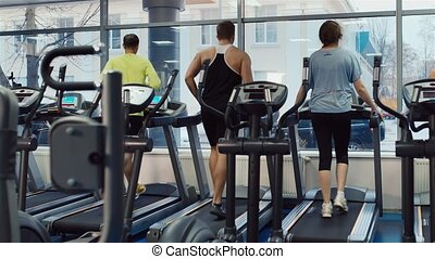 People are trained on a treadmill. In the picture, there is no recognizable faces