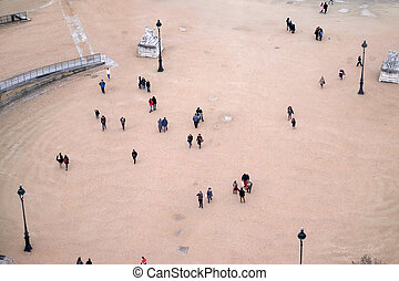 People are walking around at Jardin Des Tuileries in Paris, France