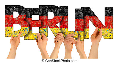 people arms hands holding up wooden letter lettering forming word Berlin capital city of germany in german national flag colors tourism travel nation concept isolated white background