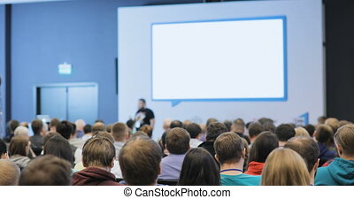 people at a conference or presentation, workshop, master class photograph. Back view