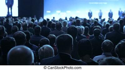 people at a conference or presentation, workshop, master...