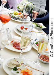 People at a dinner party - view of the table with an array...