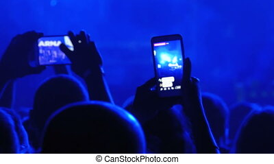 People at a Rock Concert are Broadcasting Live on the Social Network using Smartphone