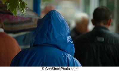 People at bus stop under rain
