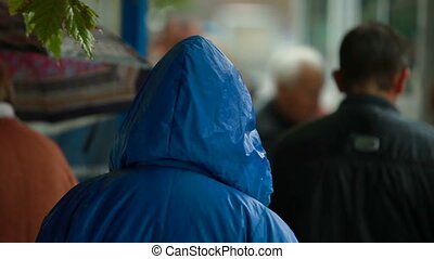 People at bus stop under rain