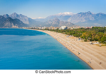 People at Konyaalti beach in Antalya, Turkey