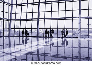 People at modern building looking at urban view