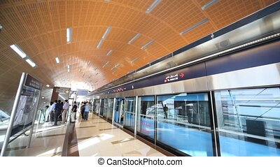 People at monorail station in Dubai, UAE.