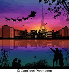 People at night in Paris with santa claus and deers silhouettes flying over a city