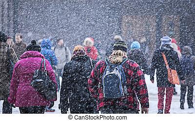 People walking at street in snowstorm