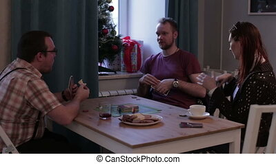 People at table playing a board game with cards