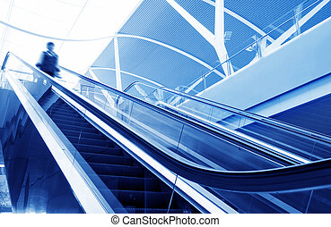 People at the airport escalator
